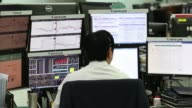 A foreign currency dealer works in a dealing room of KEB Hana Bank in Seoul South Korea on Monday Sept 4 A foreign currency dealer looks at a monitor...