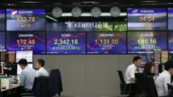 Foreign currency dealers work in a dealing room of KEB Hana Bank in Seoul South Korea on Monday Sept 4 A foreign currency dealer works in a dealing...