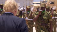 Foreign Secretary Boris Johnson watching Somalian troops on an official visit to Mogadishu