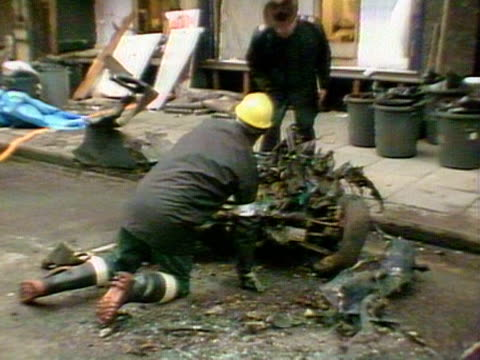 Forensic teams check the wreckage of a car bomb outside the Harrods department store 1983