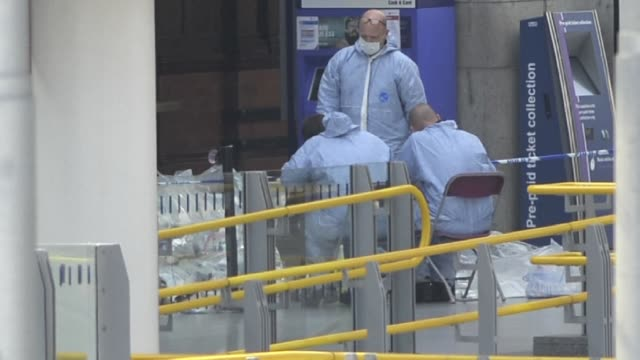 Forensics officers carry out investigations at Manchesters Victoria Station following a suicide bombing at the nearby Manchester Arena in northern...
