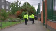 Police launch murder investigation over death of 14 year old boy ENGLAND London Newham EXT Various shots police cordon at scene where Corey Junior...