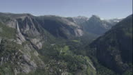 Forested mountains characterize Yosemite National Park, California. Available in HD.