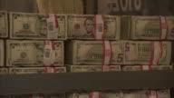 MS ZO Forklift carrying stacks of five dollar bills in bundles of $500 into vault / Kansas City, Kansas, United States