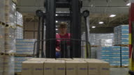 MS POV Forklift driving forward with pallet drives past  / Chelsea, Michigan, United States