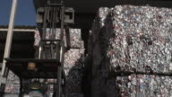 CU Forklift picking up bundled aluminum cans at recycling centre, Dallas, Texas, USA