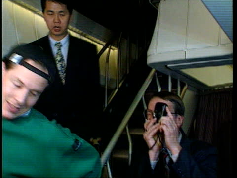 Former Barings trader to be freed LIB Nick Leeson down steps of aircraft and thru door Leeson escorted along with press around