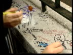 Death announced ITN ENGLAND London Abbey Road People writing messages on wall outside recording studios where The Beatles recorded many records after...