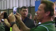 Former bodybuilder actor and California governor Arnold Schwarzenegger presides over a bodybuilding competition in Brazil
