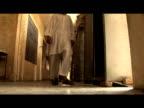 Former child Taliban soldiers walk along corridor step through doorway 3 August 2009