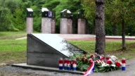 Former Croatian paramilitaries on Thursday replaced a memorial plaque with a pro Nazi slogan at a memorial site not long after it had been removed...