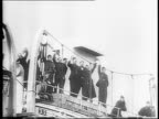 Former English POWs waving from hospital ship Atlantis as it pulls into dock / people from dock waving and cheering / soldiers on decks of ship...