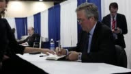 Former Florida Governor Jeb Bush arrives for a book signing of his new book 'Immigration Wars' which was coauthored with Clint Bolick during the...