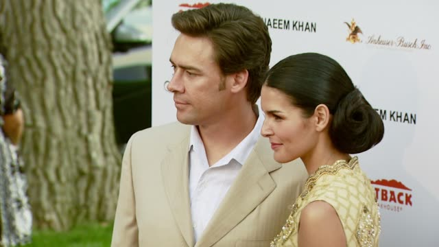 Former football player Jason Sehorn and Angie Harmon at the DesignCare 2007 at the home of Tammy and Eric Gustavson in Malibu California on July 22...