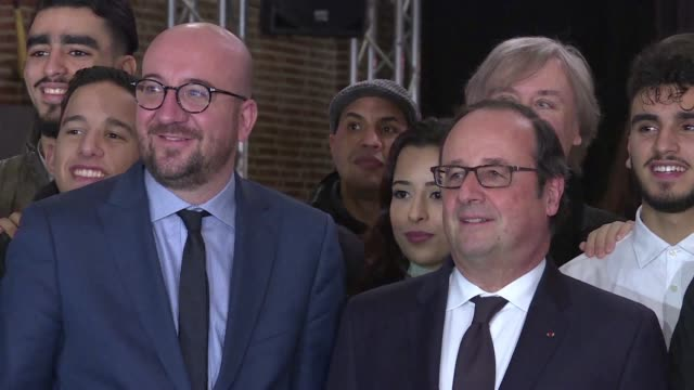Former French president Francois Hollande and Belgian Prime Minister Charles Michel attend an exhibition by French cartoonist Plantu in Molenbeek
