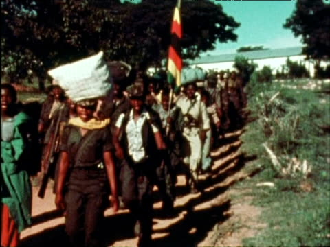 Former guerilla troops march in protest against treatment from new government 1980s