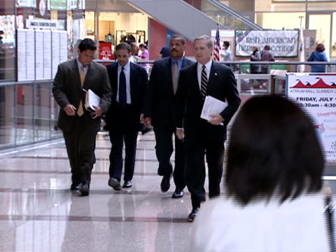 Former Illinois Attorney General Jim Ryan walks out of the Thompson Center in Chicago in 2002