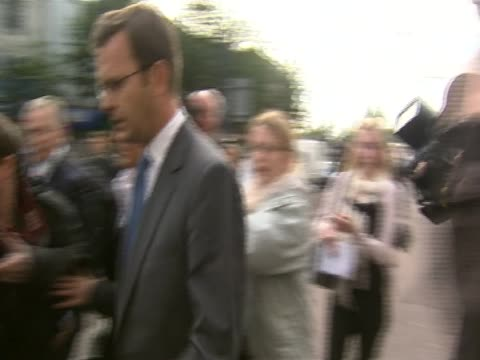 Former News of the World editor Andy Coulson is surrounded by journalists and photographers August 2011