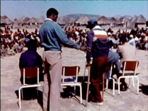 Former Nkomo guerilla fighter addresses large crowd of villagers 1970s