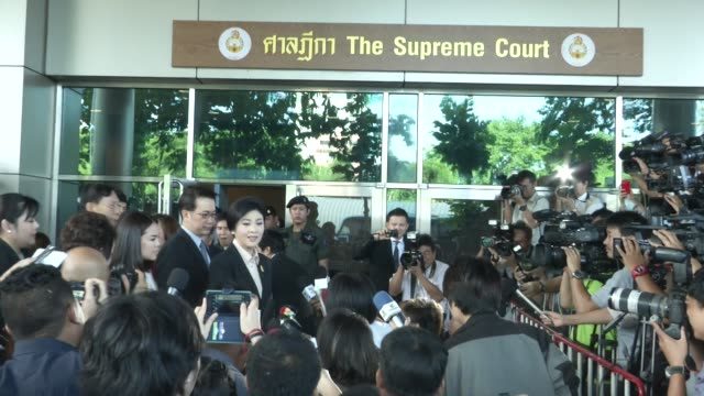 Former prime minister Yingluck Shinawatra arrives greets people and press at the Supreme Court for the opening hearing of the derelictionofduty case...