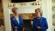 Former Senator Hillary Clinton chats with supporters during a campaign stop at the home of Chuck and Linda Smoley on June 13 2015 in Sioux City Iowa...