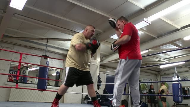 Former special forces soldiers to take part in charity boxing event ENGLAND London INT Various of Phil Campion training in boxing ring before taking...