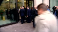 Former Sun royal correspondent in court on hacking charges *** WARNING Duncan Larcombe walking along road with wife / Press gathered outside court /...
