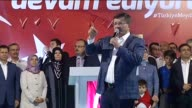 Former Turkish Prime Minister Ahmet Davutoglu addresses citizens who gathered at Mevlana square to protest the failed military coup attempt by...