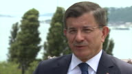 Former Turkish Prime Minister Ahmet Davutoglu saying 'our freedom has been attacked our parliament has been bombarded innocent people have been...