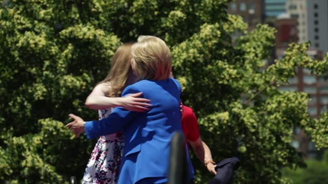 Former US President Bill Clinton his daughter Chelsea and soninlaw Marc Mezvinsky join his wife Democratic US presidential hopeful and former US...