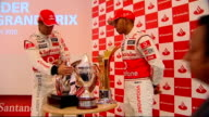 Formula One British Grand Prix preview Lewis Hamilton and Jenson Button photocall and interview Hamilton and Button along corridor TRACK ALONG /...