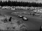 Formula One German Grand Prix GERMANY Nurburgring EXT PAN flags / LS Massed start / MS Cars cornering / GV Corner of circuit / CU Cars corner / GV...