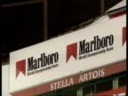 Belgian Grand Prix Tobacco advertising ban ITN MS sign 'Marlboro' GV race track with van parked and distant 'Marlboro' advertising hoarding TGV part...