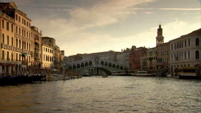 Forward tracking shot along the Grand Canal in Venice towards the Rialto Bridge.