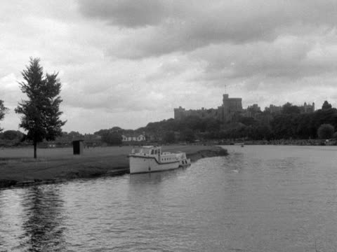 Forward tracking shot along the River Thames heading towards Windsor Castle