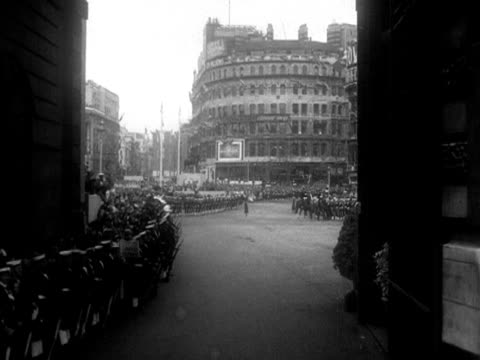 Forward tracking shot on the day of the Coronation moving through Admiralty Arch and towards huge crowds at Trafalgar Square 1953