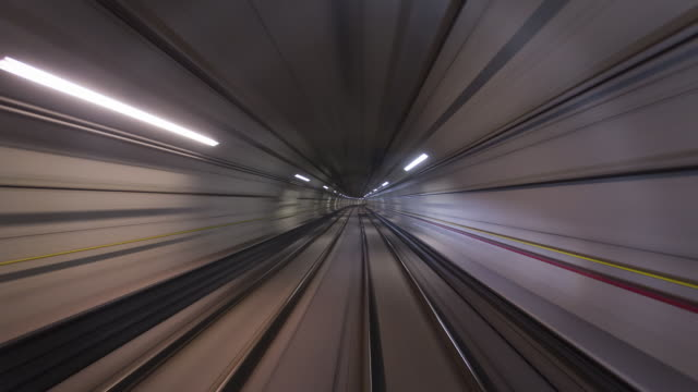 TL, WS, POV Forward view from a train travelling through a tunnel at high speed / Sao Paulo, Brazil
