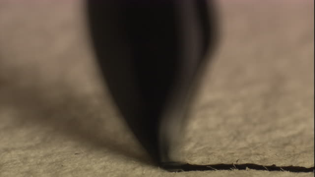A fountain pen writes on paper. Available in HD.