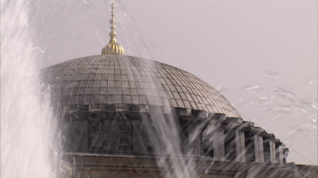 Fountains spray in front of the Sultan Ahmed Mosque in Istanbul. Available in HD