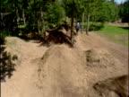 HA TS Four BMX bikers doing jumps and tricks / USA