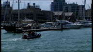 Four British yachtsmen missing in Atlantic Father of Andrew Bridge interview Southampton EXT Boats in harbour RIB boat along in harbour past yacht...