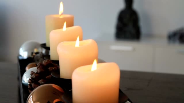 Four burning candles in advent