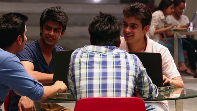 Four college students studying in the college