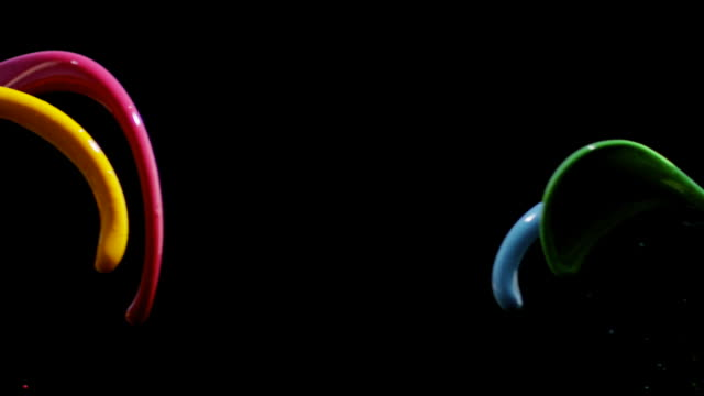 Four colored liquids colliding