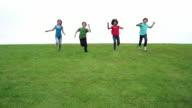 Four kids run down a hill