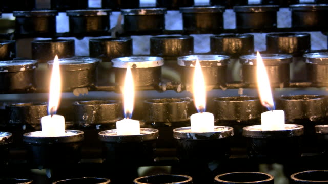 Four peaceful candles burning