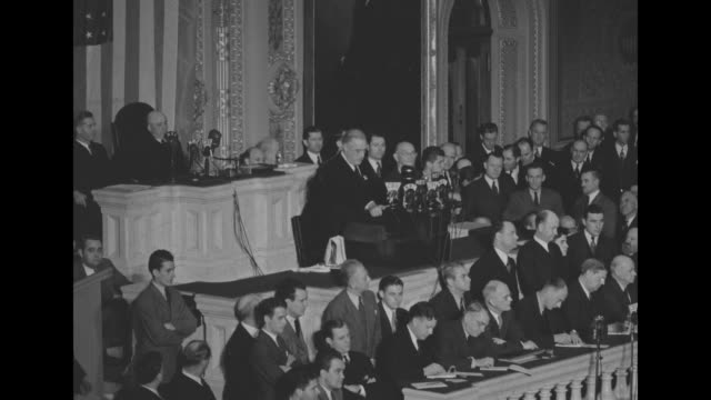 Four shots of US President Franklin Roosevelt speaking while standing at rostrum in Senate chamber to joint session of Congress Vice President Henry...