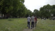 Four teens walking away from the camera.