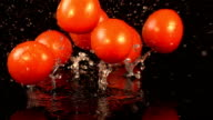 Four videos of falling cherry tomatoes in real slow motion