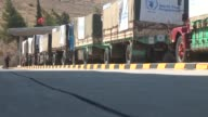 Fourteen UN trucks loaded with humanitarian aid arrive at the Cilvegozu border crossing on their way to the wartorn Syrian city of Idlib from the...